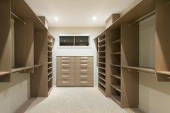 Modern walk in wardrobe. Big empty walk in wardrobe in luxurious house stock photo
