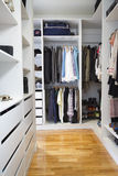 Modern walk in wardrobe vertical. Modern walk in wardrobe in a contemporary home Royalty Free Stock Image
