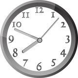 Modern wall clock in silver color frame Royalty Free Stock Photo