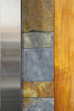 Modern wall design. Wood,stone and stainless still royalty free stock photography