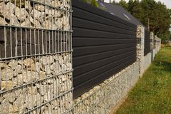 A modern wall. A fragment of a long fence of a house made with t stock images