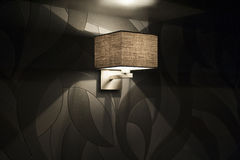 Modern wall lamp in the bedroom Stock Photography