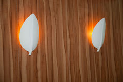 Modern wall mounted metal light fittings Stock Photo