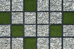 Modern wall stone with green grass Royalty Free Stock Image