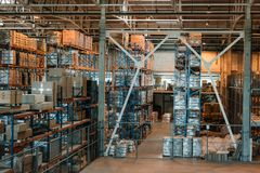 Modern warehouse interior with boxes and containers. On shelves Royalty Free Stock Photo