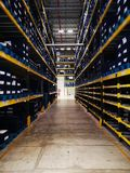 Modern warehouse within plastic boxes and the shelf stocking raw material stock images