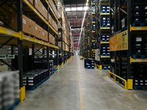 Modern warehouse within plastic boxes and the shelf  stocking raw  material Stock Photography