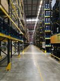 Modern warehouse within plastic boxes and the shelf stocking raw  material Royalty Free Stock Images