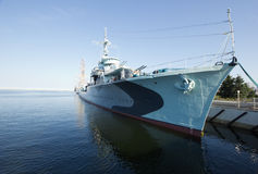 Modern warship in the bay with sailing ship in background Stock Photography