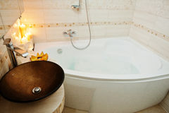 Modern washbasin in bathroom with burning candles Stock Photo