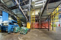 Modern waste recycling processing plant. Separate garbage collection. Recycling and storage of waste for further disposal royalty free stock photo