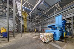 Modern waste recycling processing plant. Separate garbage collection. Recycling and storage of waste for further disposal royalty free stock image