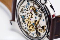 Modern Watch, Close-up. A modern watch, showing internal and complicated movement Stock Image