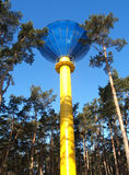 Modern water tower in the pine wood, the bottom view Stock Photo