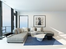 Modern waterfront living room interior. Modern waterfront living room with a bright airy lounge interior with a comfortable modern upholstered grey suite , art Royalty Free Stock Photos