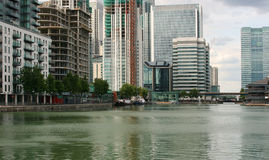 Modern waterside city landscape. Canary Wharf waterside development of luxury apartments and corporate buildings Royalty Free Stock Photo