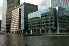 Modern waterside offices. Looking over water at modern waterside offices stock image