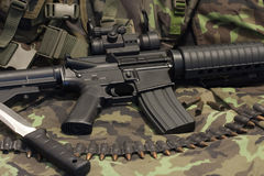 Modern weapon M4. Camouflage background Stock Photography