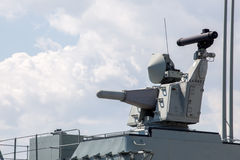 Modern weapons on the deck of a military ship. Weapon system for defense Royalty Free Stock Photography