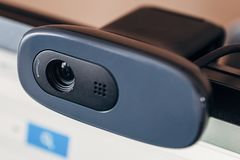 Modern web camera on computer monitor. Digital device for online conference, broadcasting and video communication by internet. Close up royalty free stock image