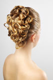 Modern wedding hairstyle. On gray Stock Photo