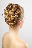 Modern wedding hairstyle. On gray Stock Photo