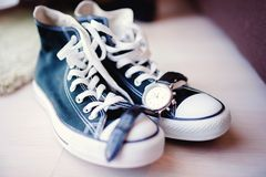 Modern wedding with sneakers instead of classic shoes Royalty Free Stock Photography