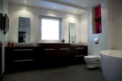 Modern white bathroom with brown furniture. Modern big white bathroom with brown furniture and bath stock images