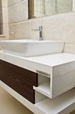 Modern white bathroom sink and cabinet royalty free stock photos