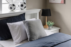 Modern white bed with pillow and  football on top Royalty Free Stock Photography