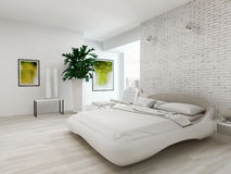 Modern white bedroom with bed against brick wall Royalty Free Stock Photography