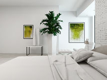 Modern white bedroom with bed against brick wall Royalty Free Stock Image