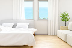 The modern of white bedroom bed sheets and pillows ,comfort and bedding concept and sea beach background at windows, 3D. The modern of white bedroom bed sheets Royalty Free Stock Photo