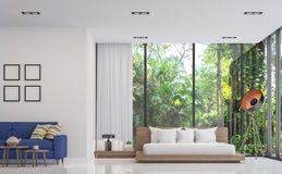 Modern white bedroom and living room with nature view 3d render image. There are white floor .There are large window overlooking to the garden and nature and Royalty Free Stock Photos