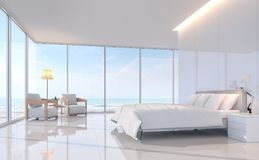 Modern white bedroom with sea view 3d rendering image. There are white tile floor and white glossy wall.Furnished with white furniture.There are large window Royalty Free Stock Images