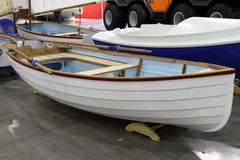 Modern white boat with oars stowed along the side Stock Images