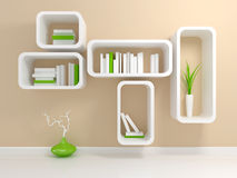 Modern white bookshelf. With a white and green books against beige wall Royalty Free Stock Photo
