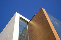 Modern white and brown corporative building with a very lined contour. stock photography