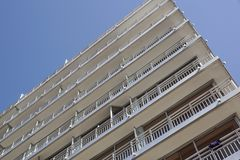 Modern white building with balcony on a blue sky.  Royalty Free Stock Images