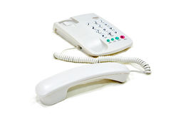 Modern white business office telephone. On a white background Stock Photo