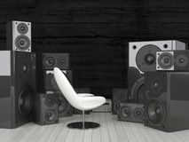 Modern white chair surrounded by huge soundspeakers Royalty Free Stock Photo