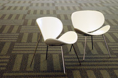 Modern white chairs Royalty Free Stock Photos