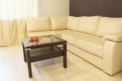 Modern white corner leather sofa and coffee table. Stock Photography