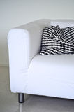 Modern white couch. A modern white couch with black and white chequered cushions Stock Images