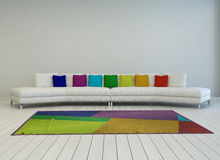 Modern white couch with colorful cushions Stock Image