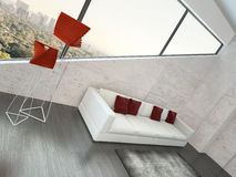 Modern white couch with red pillows against stone wall Stock Photos