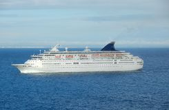 Modern white cruise ship approaching port. Exciting family vacation on board a large Carribean cruise liner Stock Photo