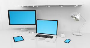 Modern white desk interior with computer and devices 3D renderin. Modern white desk office interior with computer and digital devices and blue screen 3D Royalty Free Stock Photo