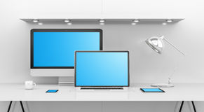 Modern white desk interior with computer and devices 3D renderin. Modern white desk office interior with computer and digital devices and blue screen 3D Royalty Free Stock Images