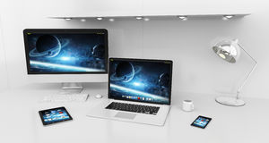 Modern white desk interior with computer and devices 3D renderin. Modern white desk office interior with computer and digital devices and blue screen 3D Stock Images